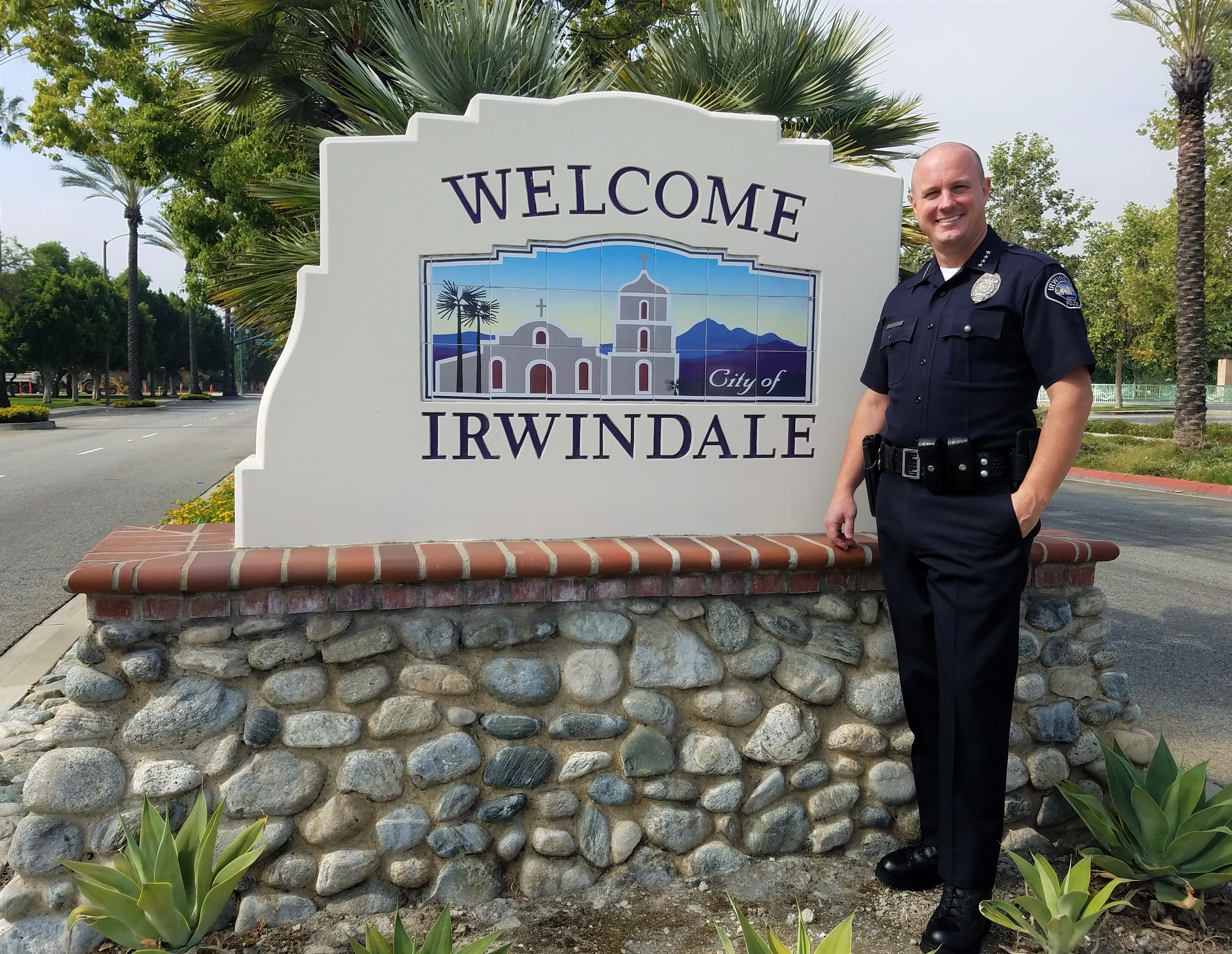 "Ty Henshaw by ""Welcome Irwindale"" sign"