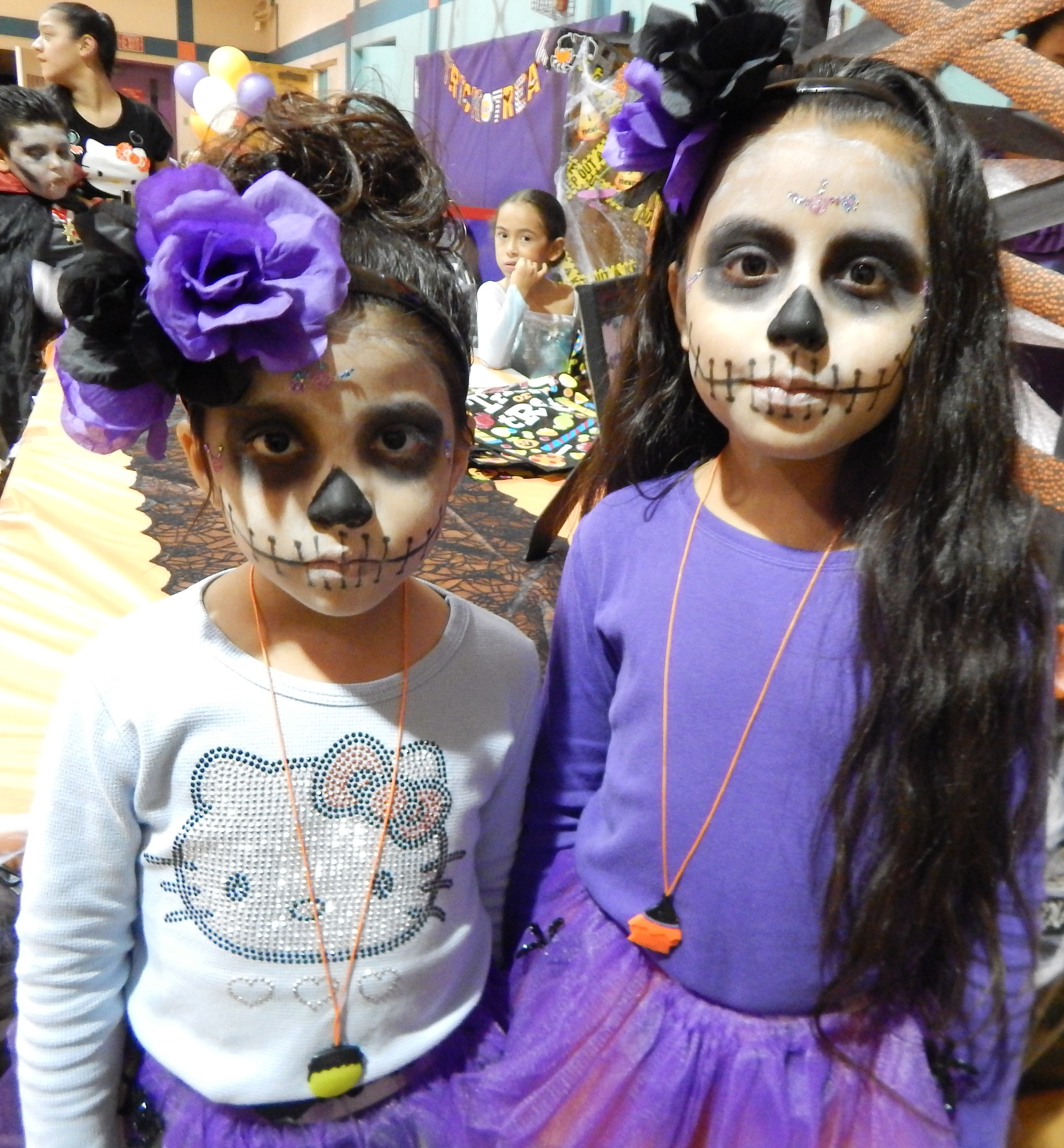 two girls with painted faces