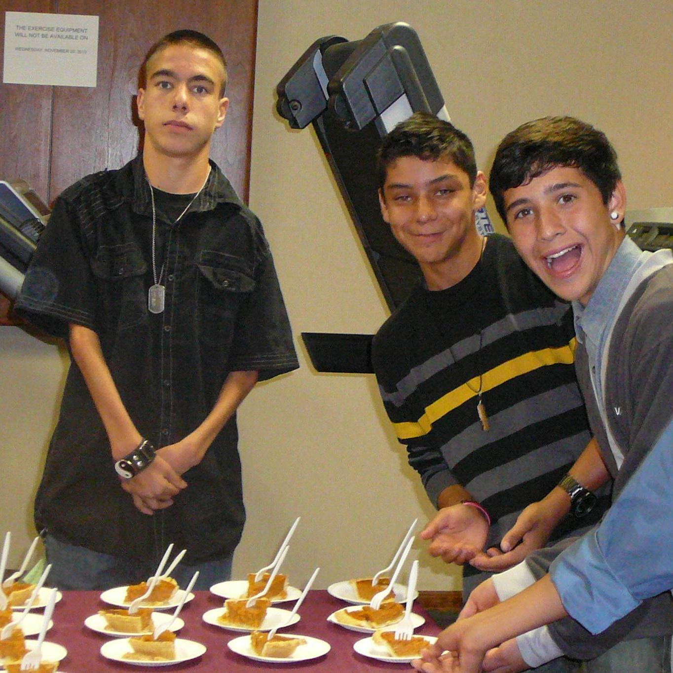 teens serving pie